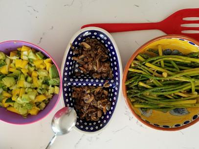 Vegetarian buffet style Avocado mango salad, mushrooms and saute asparagus.