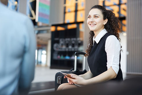 smiling-young-woman-waiting-in-airport-6