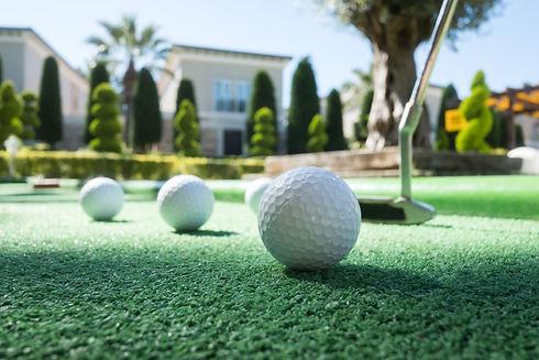 mini-golf-scene-with-ball-and-club-PAHTW
