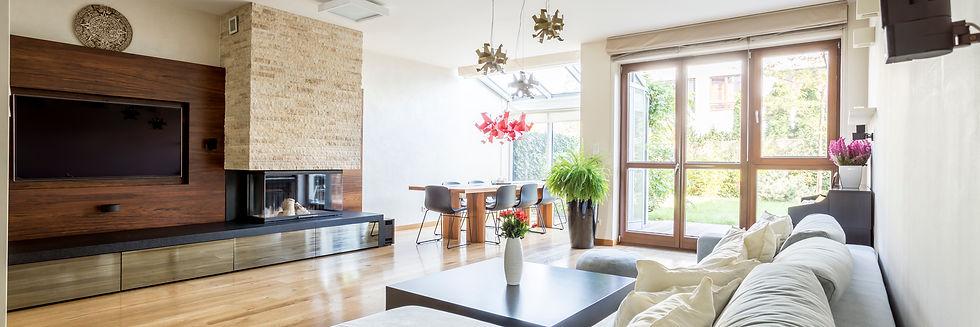 tv-living-room-with-balcony-PTNZQ5C.jpg