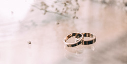 two-silver-colored-rings-on-beige-surfac