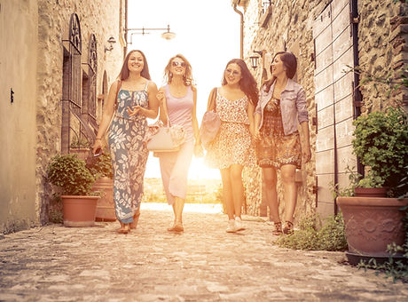 Group of girls walking in a historic cen