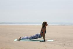 Up dog yoga pose on the beach