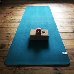 Turquoise yoga mat, cork block and pink yoga strap