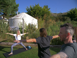 Yoga practice in front of the yurts