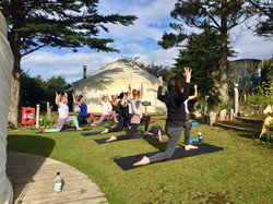 Practicing yoga outside on our Women and Water retreat