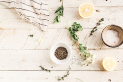 delicate herbs and spices prepared on white wooden table