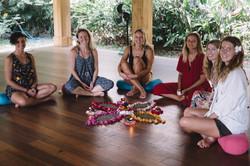Yoga teachers celebrating completing their yoga teacher training