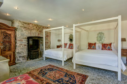 Four poster beds set in tranquil setting