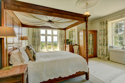 Four poster bed with Devon views