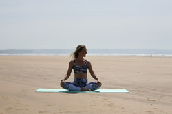 Amanda Bunton yoga pose on the beach