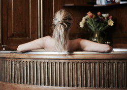 relaxing in large bath