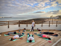 Yoga on the outside area at the surf villa