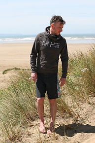 Wild and Free grey hoodie for men and women on the beach