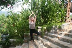 Yoga pose on steps with dappled sunlight