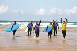 retreat guests celebrating post surf