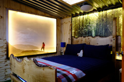 Illuminated bedroom at Loveland Farm