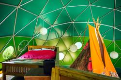 Sleeping area on mezzanine in geodesic dome