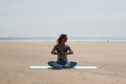 Seated yoga pose on the beach