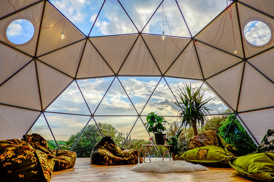 Geodesic dome living area with camo bean bags