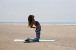 Slight backbend pose on beach