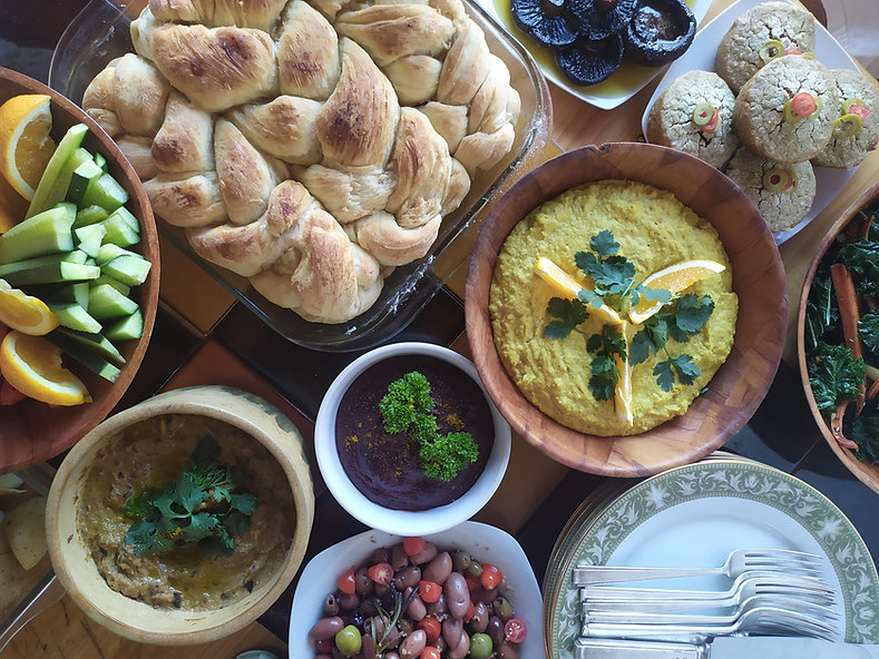 beautifully cooked vegan food, humous, bread