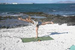 Warrior 3 pose on the beach in Fuerteventura