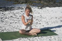 Amanda Bunton with singing bowl on the white sand