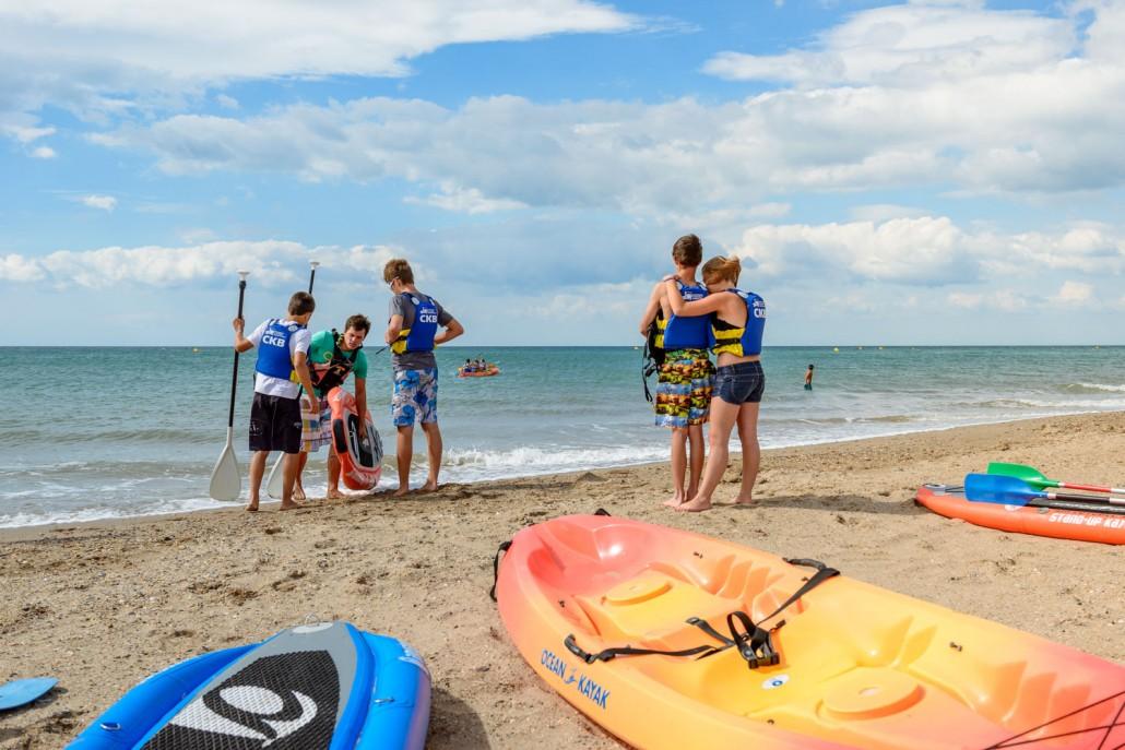 stand up padlle et kayak en mer