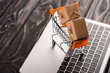 toy-boxes-in-small-shopping-cart-on-lapt