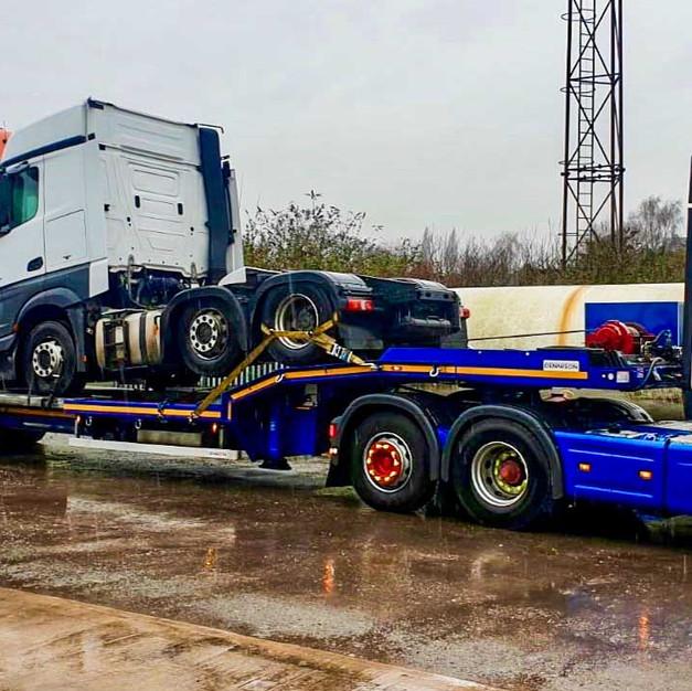 Truck loaded on extender, low loader