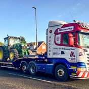 Tractor on low loader.jpg
