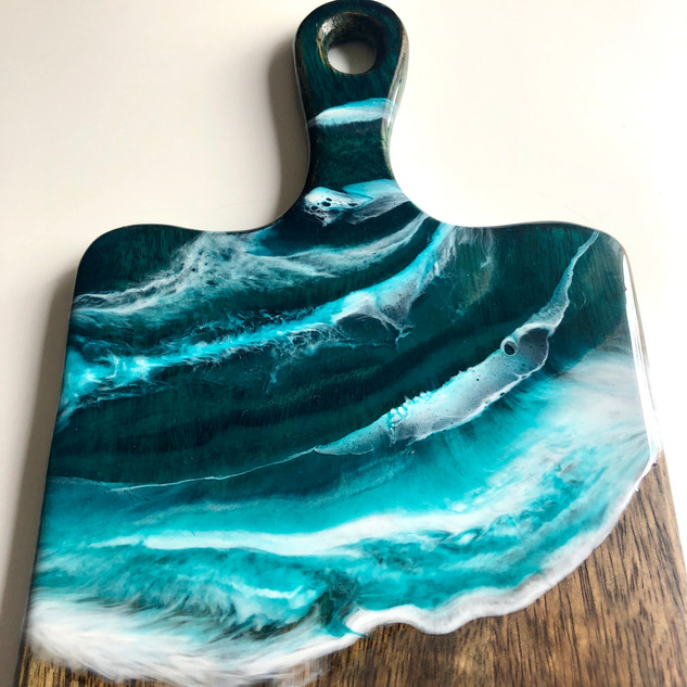 acacia serving board decorated with resin beach artwork