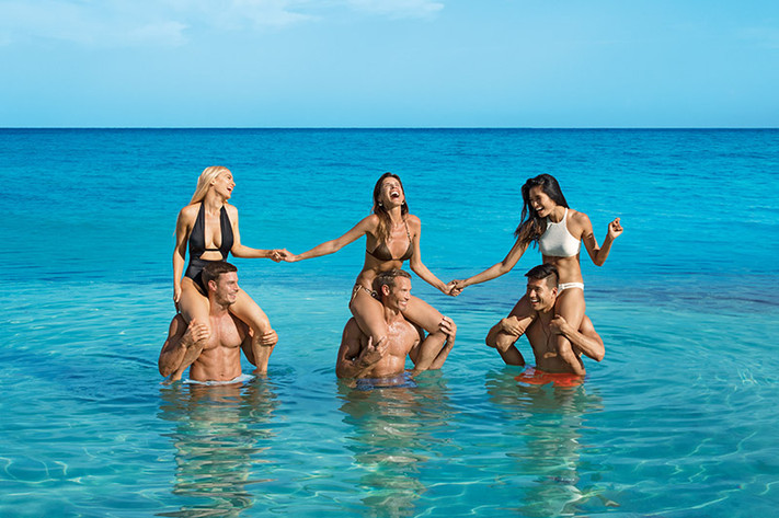 Group of friends playing in the sea.jpg