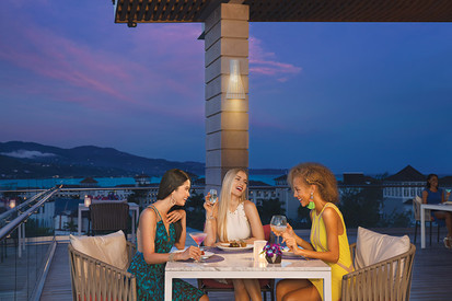 Friends at Altitude rooftop restaurant.j