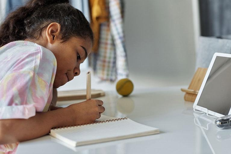 Canva---Photo-of-Girl-Writing-on-White-P