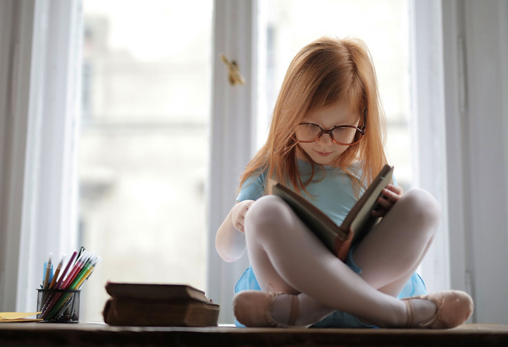 Canva---Girl-In-Blue-Dress-Reading-A-Boo