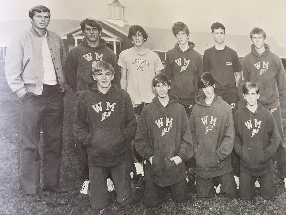 1969 Ward Melville cross country team. Front row (left to right) Craig Macdonald, John Hebert, John Brubaker, Ken Robinson. Top row: Coach Stephen Goodwin, John Regan, Steve Ivy, Jeff Davison, Joe Rees, Michael Hankes.
