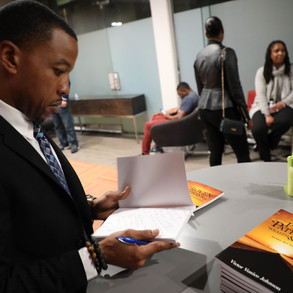Signing a book again (Nia's Event).jpg