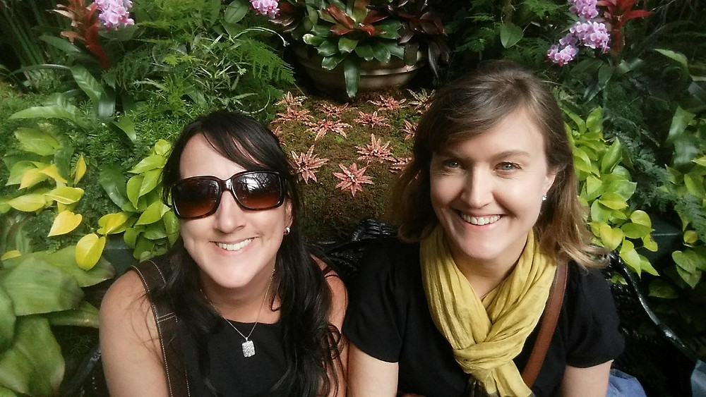 Photo of two women in botanical greenhouse