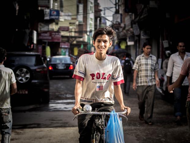 street photography Nepali boy on bike in Kathmandu