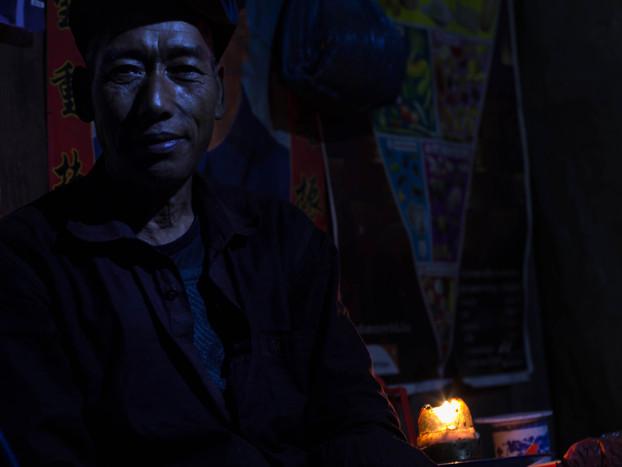 travel photography Laos akha village man