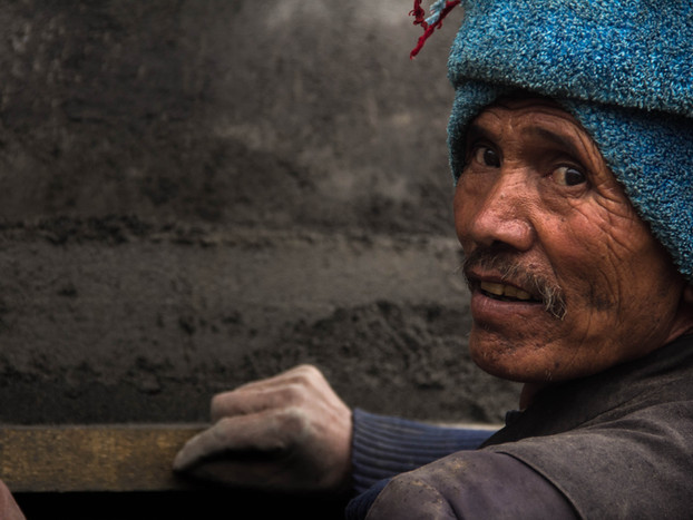 travel photography Nepali man working in Upper Pisang