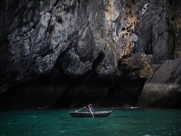 Travel Photography rowboat fisherman in Halong Bay