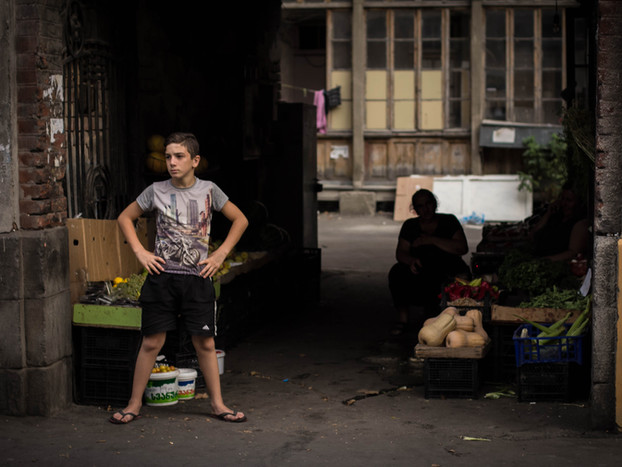 Street Photography Georgian boy as fruit vendor in Tbilisi