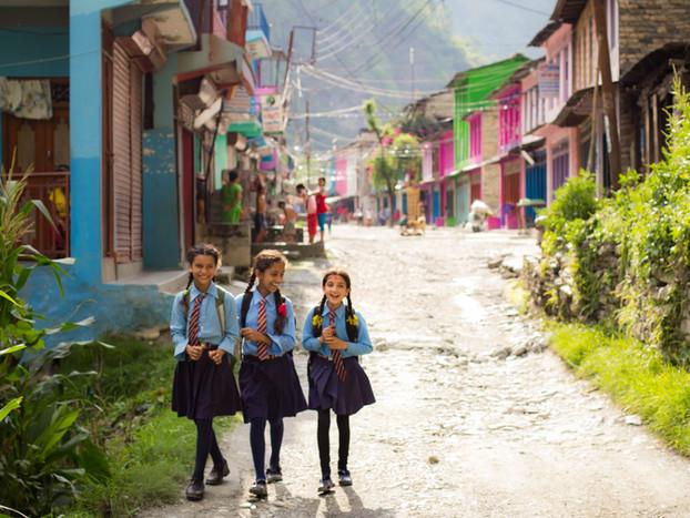 Travel Photography Nepali schoolgirls going home
