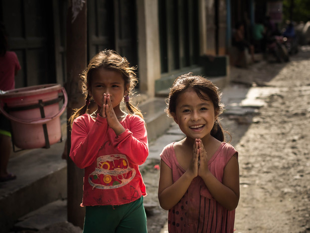 street photography Nepali girls say namaste