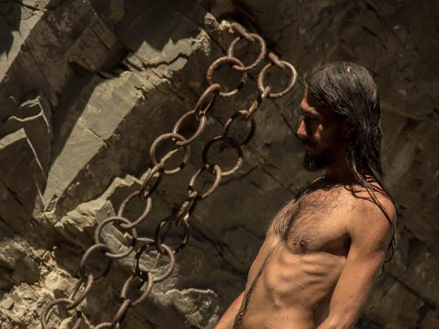 travel photography man by chains Dzveli Tbilisi