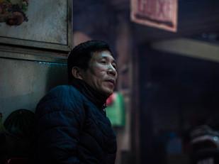 vietnam street photography man sitting in alley