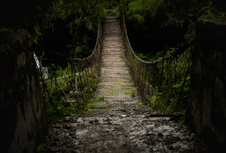 Travel Photography old wooden suspension bridge in Nepal